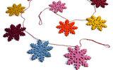 Fairtrade Sneeuwvlok slinger van vilt. GreenPicnic